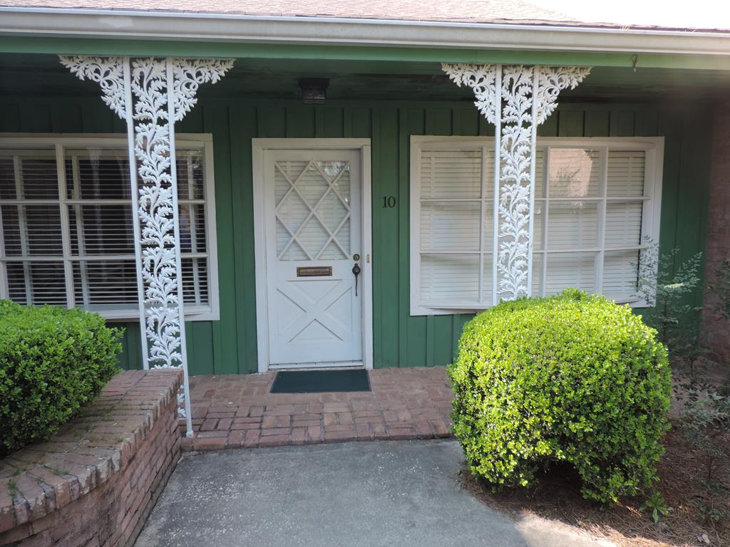 Leisure Living in Colonial Village!  Simple features of this unit set it apart from all the others.....it's ONE LEVEL - NO CLIMBING STAIRS!  It's a CORNER unit!  It's within walking distance to downtown Thomasville's brick street shopping, restaurants, entertainment, Archbold Hospital, doctors and attorneys offices, banks, etc. Upgrades include new flooring and fresh paint.  Covered parking for two vehicles and private exterior brick patio affirms this unit's leisure lifestyle while you enjoy the HOA management of maintenance and repairs while you relax and plan your next excursion in beautiful Thomasville. Both bedrooms have closets that I envy given their size-HUGE!  Oh, and did I say it can also be leased furnished for $1,900/month or without furnishings for $1,200/month.   But, with a price of $157,000, why rent when you you can buy! CURRENT INTEREST RATES ARE AT AN ALL TIME LOW!  YOU COULD SEE YOURSELF BEING QUARANTINED IN THIS UNIT....IT HAS  EVERYTHING AND CLOSE TO EVERYTHING!