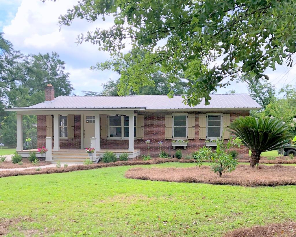 Completely renovated brick home in established neighborhood. Features include three bedrooms, three full baths, metal roof, tongue and groove walls, luxury vinyl plank floors, open floorplan, workshop with awning and more.  Conveniently located just minutes from Publix and from downtown Thomasville's shopping and dining.