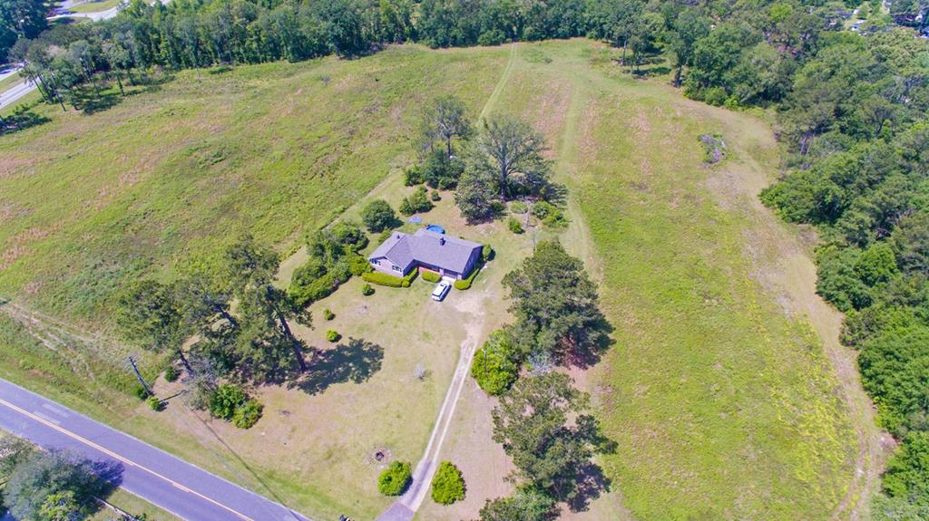 16 +/- acres zoned RM11. Located at the corner of Cassidy Road on 84 bypass. This tract offers many possibilities. Would make a great residential development or commercial tract. Good soils and a great location. Improvements include 3 BR/2 BA nice brick home which is currently leased. Owner/Agent R.E. Lic. #308020.  See MLS # 915866