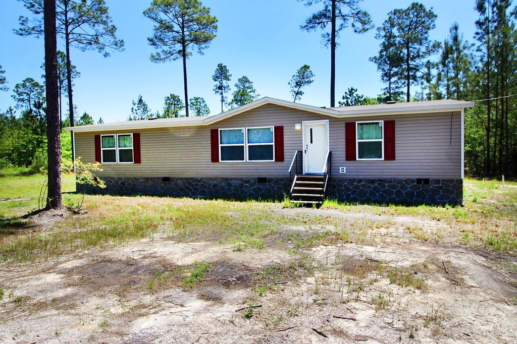 Location Location Location, this 43.64 offers something for everyone.  There is a brand new 28x56 2019 mobile home, with septic tank and private well already installed.  This tract would be perfect for a fishing/hunting camp, or the perfect place to build your dream home on your private pond.  For those that want to hunt and fish, the land offers deer, turkey, ducks, and plenty of fish!!  If you want both hunting and dream home?? Build on the front and hunt on the back part of the property, again there are so many possibilities with this unique tract that located literally minutes from town! Call today to get more info!!
