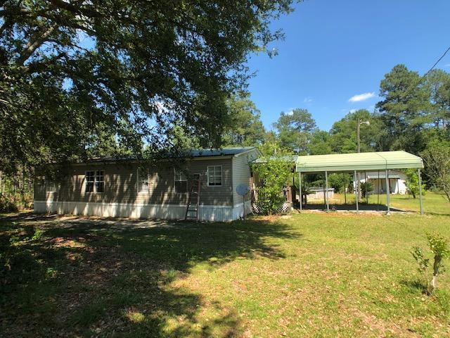 Located in Thomas County GA.  Mobile Home with approx 23 acres and a metal roof that is secluded.  The property has is approx 10 miles north of Wal Mart in Thomasville and features a mobile home with sheds and above ground pool.  The interior needs minimal TLC.  The property also includes 2 power poles, 2 septic tanks, and multiple fruiting trees which include a satsuma, lemon, and Kumquat trees with Pear trees as well. The majority of the property is fenced in and is in the CRP program and the owner brings in approx $1700 a year.    Shared well agreement.  Subject to survey. The mobile home is pined but does not have a permanent foundation. CAUTIOUS DOGS WILL BITE.