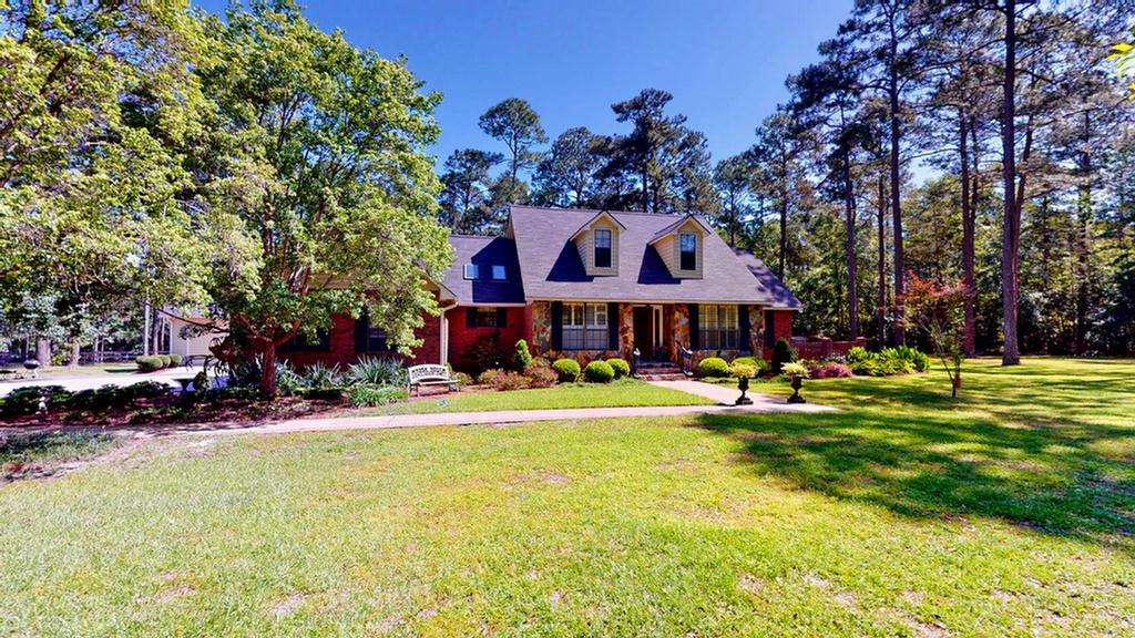 Incredible 3 bedroom, 2.5 bath home on a private 6.75-acre lot. Spacious front & back yard that are beautifully landscaped & provides plenty of space to entertain. You will also find a separate 2 story three-car garage on the outside as well as a lovely greenhouse. Walking through the front door you are immediately greeted by the formal dining area as well as the spacious living area. The living area features a stone fireplace, connects to the kitchen and a light and airy sun room, perfect for relaxing after a long day. In the kitchen, you will find lovely hard surface countertops, miles of cabinet & counter space, stainless steel appliances, kitchen island, & breakfast area! The master bedroom is large and connects to the master bath with his and her sinks and much more! The master bed also connects to your own private room that can be used as an office. Upstairs you will find two more bedrooms connected by a jack & jill bath.The house is well maintained & the location is the best!