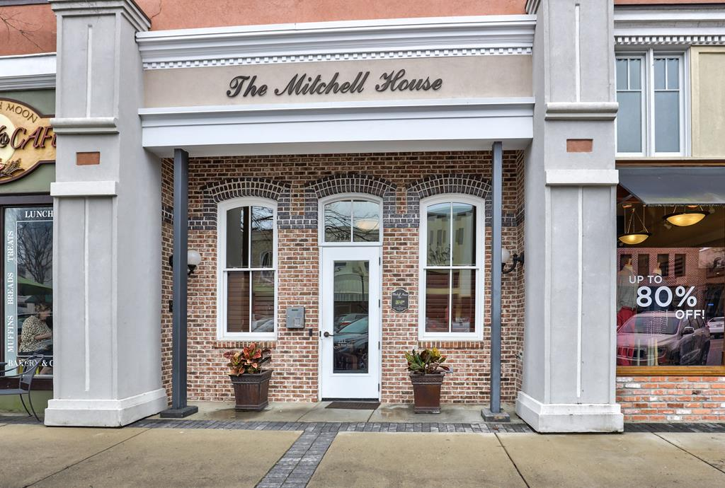 Beautiful totally renovated Mitchell House Condo. Very spacious 2nd floor unit, original pine flooring, 12 ft ceilings with exposed brick walls and many upgrades including: plantation shutters throughout, marble countertops in kitchen and baths, Merillat cabinets, Viking appliances, built-in wall units, custom closets in both bedrooms, pantry, laundry room and linen closet, high end ceiling fans, freshly painted, alarm system & many others.   Excellent view of downtown, condo faces Jackson Street. The parking lot is gated and has deeded parking.  This unit also has a 53 sq foot storage area in basement of the building.  HOA fees include maintenance & insurance of the common areas and building.  Don't miss out on this renovated Condo in the very desired Mitchell House with downtown living close to shops, restaurants, churches and parks!  Seller has recent survey.