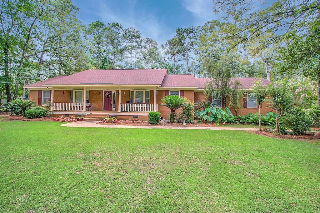 Nice brick 3 BR, 2.5 Bath home located on .62 acres south of Thomasville in A Place in the Woods subdivision.  Large Family Room with vaulted ceiling and a fireplace, formal dining room, open spacious kitchen and breakfast room, bay windows, built-ins, desk and pantry.  Nice master suite with new custom shower and a large master bedroom with access to back yard, laundry room with utility sink, hardwood floors in main living areas, tile and carpet; really nice screened in back porch, double garage, rocking chair front porch, beautifully landscaped yard and a very nice shop in the back yard.  Call for an appointment today.