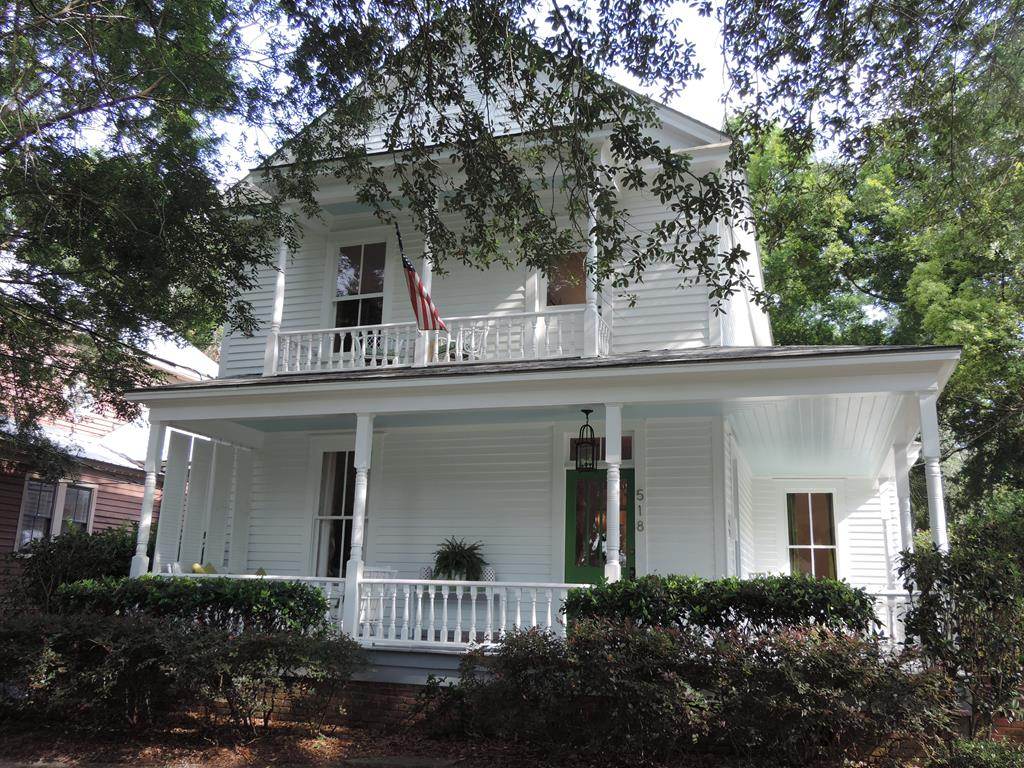 Want a move in ready Victorian within walking distance to all that Thomasville offers in the downtown area?  Look no further, this location is a 10!  Just call and schedule your appointment today!  This home lives easy with the master bedroom and walk in closet on main floor and two bedrooms and full bath on second floor. Original hardwood flooring can be found throughout this home with an abundance of windows that allows lots of natural lighting for a light and airy feel. Want to get away from it all? Then checkout the upstairs bonus space and you will find the perfect area for reading, playing games and even taking an afternoon nap. While you are upstairs, take a break on the second story porch. When approaching this immaculate home, you will note the wrap around porch on two sides which offers outside living out of the heat. You will especially enjoy the back deck, yard and shady courtyard area when entertaining friends and family. Current owners have loved this home and it shows!