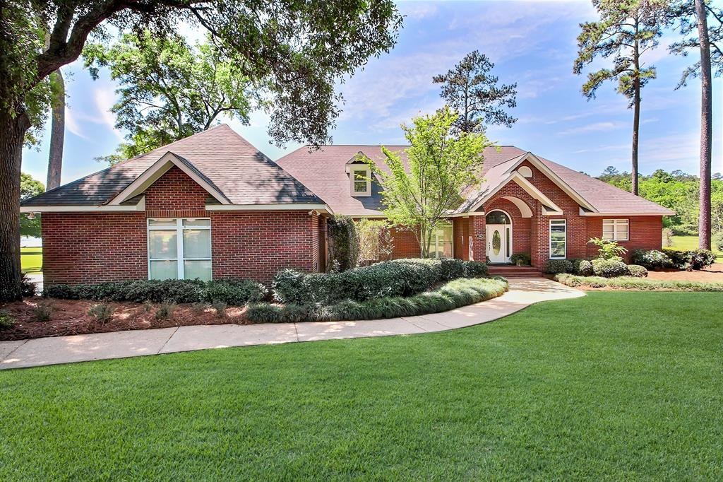 Perfect for the Large Family-Space won't be a problem in this 6 BR/4 BA brick home with approximately 4742 sq ft on the lake in the gated community of Saddlebrook Plantation. Situated on 1.49 acres with a screened porch and deck, there is also plenty of space for outdoor activities. This private community provides lots of peace and quiet, large lots, and is located on the east side of Thomasville. It has so many wonderful features and recent updates. It features a foyer; living room; dining room; family room w/ built in bookcases & fireplace; home office; large kitchen w/ center island and all appliances including a new microwave; split bedroom plan w/ 4 BR downstairs and 2 BR/1 BA upstairs; master suite w/ walnut flooring, master bath w/ double vanities, whirlpool tub and separate shower; walnut flooring in living area; 3 CHA systems; surround sound; new roof (April 2020); 3 car garage; security system and much more. At closing owner will provide Purchaser with 1 year home warranty.