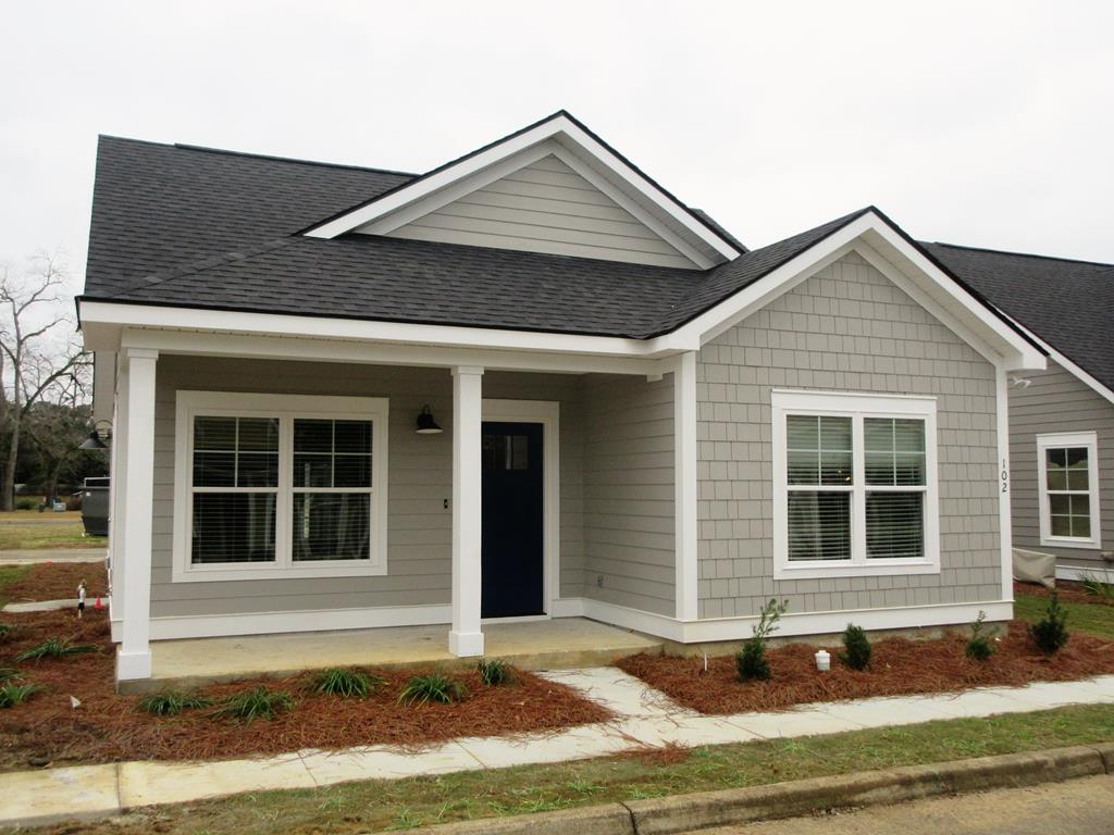 BRAND NEW CONSTRUCTION! Located in Jamestowne at MADISON GROVE!!!.  This charming cottage is ready to welcome you home and let you start enjoying the wonderful amenities of Thomasville's most popular subdivision, MADISON GROVE!  Reminiscent of Norman Rockwell and years gone by, this cute cottage features LVP flooring throughout, 9' ceilings with step-up ceilings in main living room and master suite all of which are enhanced by crown moldings, large base boards and wood wrapped windows.  The ample sized second bedroom features LVP flooring with cathedral ceilings large enough to accommodate queen sized furnishings.  The U-Shaped kitchen features custom built cabinetry, granite counter tops & stainless steel appliances.  Large utility room directly off the kitchen features LVP flooring & plenty of storage.  Rear alley way entrance features triple car parking area.  Storage Area for Bikes, Fully Landscaped & Irrigated yard and so much more!  All in Popular MADISON GROVE!!!