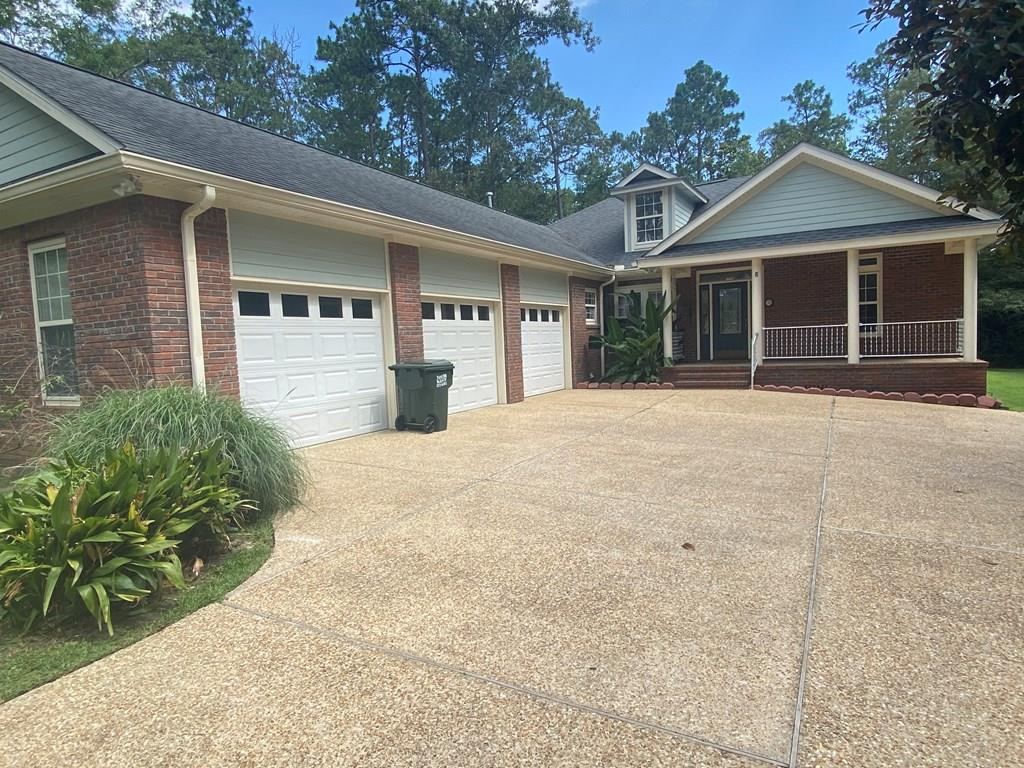 Custom Quality Home.....Well maintained brick home w/ a 3 car garage with lots of storage. Out back is an inground pool w/ a vinyl privacy fence. Step inside to vaulted ceiling, crown molding, granite countertops, hardwood floors, a split floorplan. Call today to schedule your viewing.