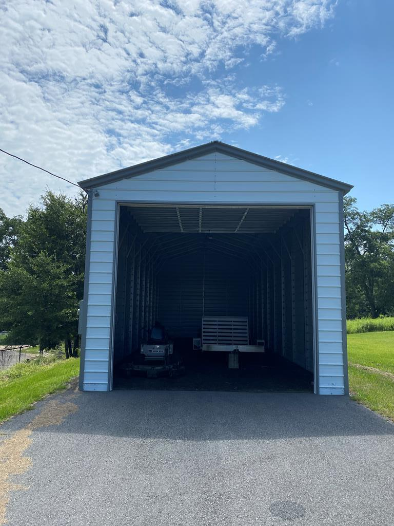 Commercial lot with a really nice metal building for RV or boat storage.  Lot is 2.11 acres.  The building measures 18 1/2 X 50 and has a 200 amp electric service and 50 amp plug in for a motor home. Seller will consider OWNER FINANCING. Located just off of hwy 84 in Cairo, Georgia.