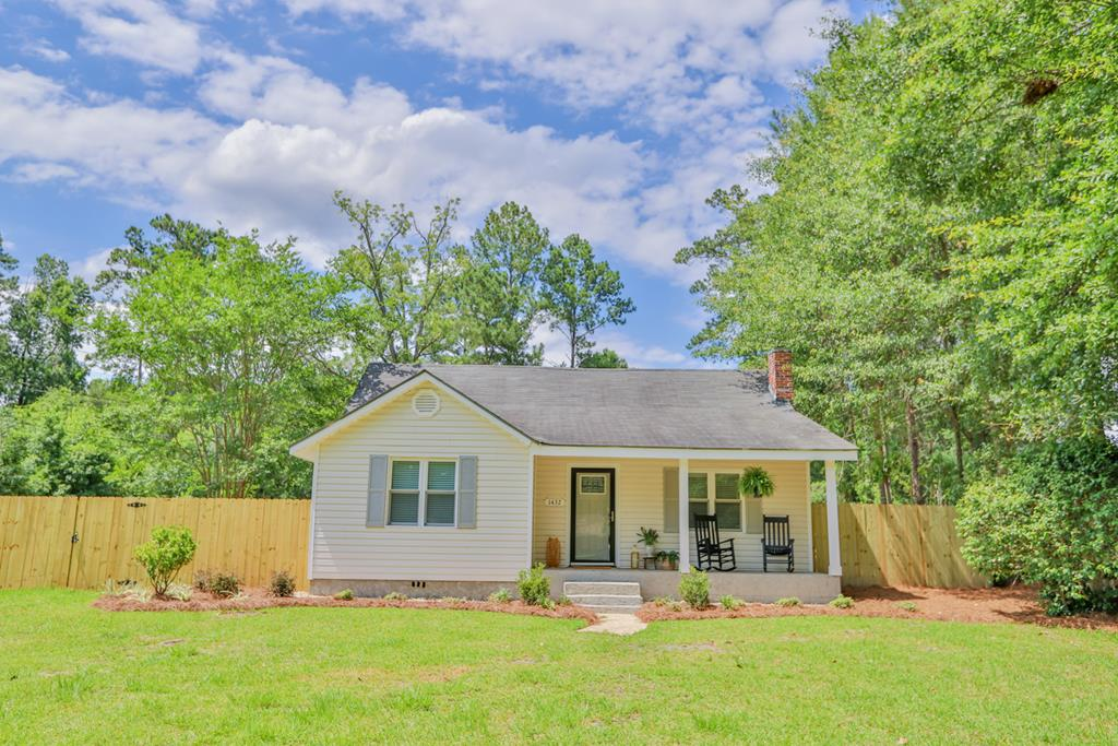 COMPLETELY REMODELED AND UPGRADED FARMHOUSE with she-shed right in town! This luxurious 3 BR/2 BA house has all of the extras. The colors and finishes are simply gorgeous and straight out of Southern Living. Features include gorgeous light and plumbing fixtures, granite countertops, new Stainless appliances, vinyl plank and marble flooring, a fireplace, and the kitchen and bathrooms are exquisite!!!! Your family will absolutely love the rocking chair front porch and back covered porch. The yard is fenced and has landscaping. The outdoor she-shed is heated and cooled!