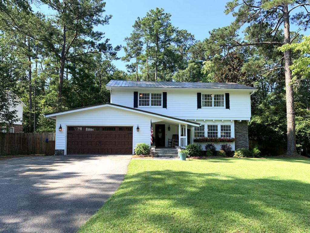Upgrades& location make this house perfect w/ the large backyard for entertaining. This home has a gorgeous new kitchen w/ granite counters,upgraded SS appliances,top of the line gas stove, new wainscot dining rm., LG living rm. w/ built in bookshelves, a separate den w/ remote control gas logs in fireplace, a double garage & a full guest bath. Upstairs you will find a beautiful large master bedroom w/ a private balcony overlooking backyard, walk in closet, plus additional 3 full sized bedrooms &another full bathroom. Then head on to the LG. sunroom perfect for play room, exercise room, or a separate living area. The deck has a new covered section for entertaining w/ceiling fan, sunshades, fire pit, outdoor kitchen cook/shed, new roof, fenced backyard, beautiful landscaping,raised garden beds,10x12 storage building, equipment storage, double garage&still has plenty of room for the kids to play. All of this in the popularJerger School/Hospital area of town. Call today for an appointment