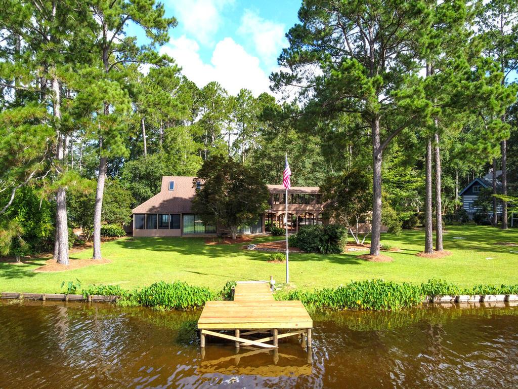 AT THE END OF THE ROAD!  Last house on the Point, 300 feet of waterfront, very private feel.  This unique contemporary home has so much character.  It is not your run of the mill traditional property by any stretch. You feel outside even if you are inside, water views from every room!  Double sided fireplace in living room/dining room, spiral staircase, screened porches on both levels are perfect for relaxing!  Skylights & roof replaced in 2013, new screens on all porches & new water heater. Bathrooms, kitchen all have new fixtures & valves,fresh paint. Outside you will find anew dock just waiting for you to bait the hook or sit & relax or you can follow the many paths through the landscape grounds. The double carport has an attached workshop or studioand that even has a large picture window overlooking the water.Dont miss the hidden area on the opposite side of the house for trash cans, garden tools etc.  All this only 10 minutes from downtown Thomasville!Call your favorite Realtor