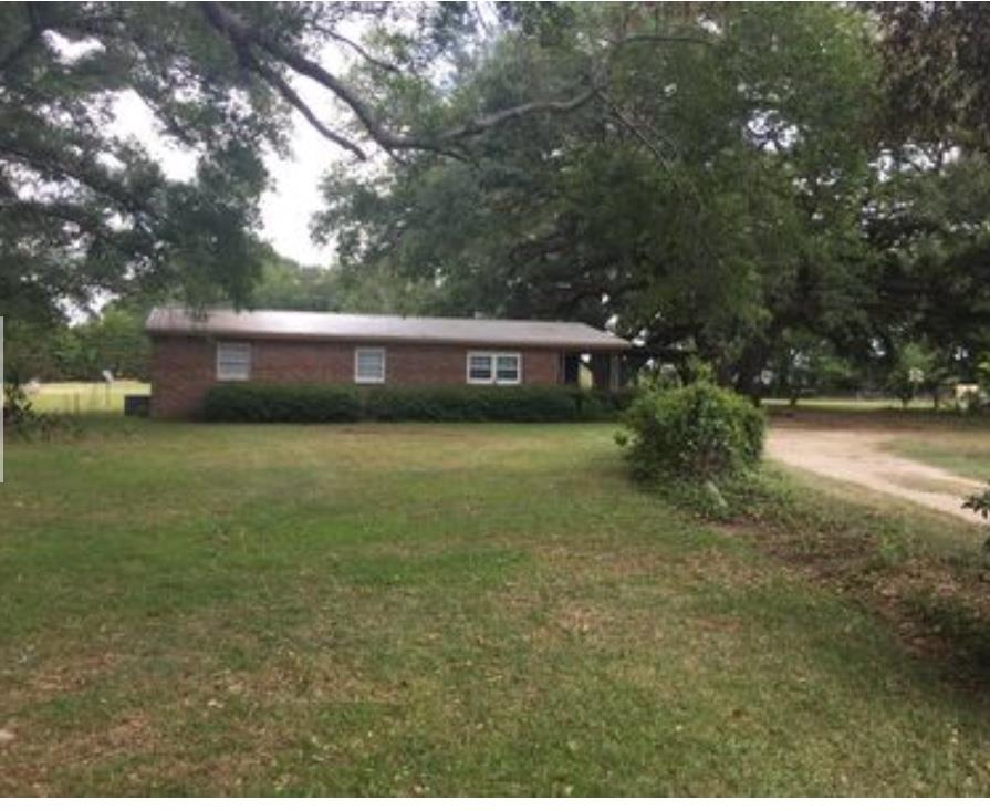 3 BR 1 1/2 Baths Brick Home between Pelham and Camilla.  Quite County Living with beautiful 100 plus year old oak trees and garden space.  Plenty of shade for those hot summer southern days.  Vaulted ceiling in the kitchen area.  French doors in the kitchen leads out to the screened back porch.  New Metal roof and Septic tank.  New linoleum floor in both bathrooms with new paint throughout.  Open porch on the front.  Also has an attached carport.  3 Bedrooms need carpet or linoleum.  Selling as Is.  Call for your appointment today.