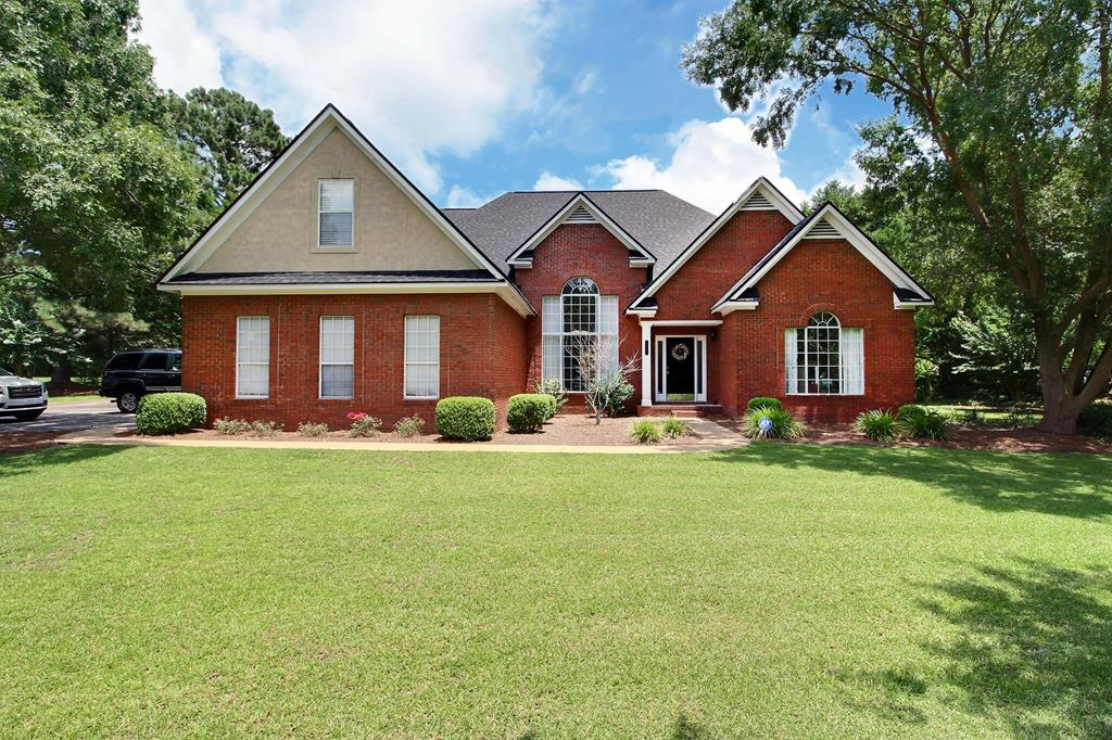 This large beautiful brick home features 4,275 sqft and has plenty of room for your growing family!!  As you enter the property, you will notice the gorgeous high ceilings that are dressed with crown molding. On the main level, the home features a master bedroom, large master bath and walk in closet.  You also have 2 additional bedrooms, a side office, 1 full bathroom, and 1 half bath all on the first floor!! The foyer is well connected with  a large formal dinning room, living room, and kitchen.  Off the side of the kitchen is a breakfast area that overlooks your large fenced backyard.  Again, this is all on the first level.  As you go upstairs, you'll see a nice loft area that could double as a bonus area.  There are 2 bedrooms and a full bathroom upstairs.  Call today to see this beautiful brick home, that offers you all the space needed!!