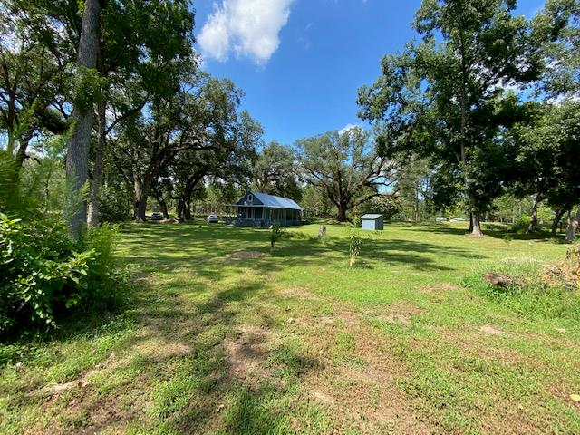 30 ACRE tract with 1 Bedroom 1 Bath 672 SF 19th century cabin.  This cabin  was originally the old stage coach building so it has lots of history. It also has a loft area for extra sleeping quarters or storage. The sellers have put on a new Roof and plumbing and have upgraded the electrical.  12 x 36 pole barn, invisible dog fence,120 plus income producing PECAN TREES. ELLIOTS, STEWARTS & MONEY MAKERS. (current year harvest does not go with the sale of the property as someone has been servicing for the trees for 2019) Currently a farmer has a short lease and will harvest the 13 acres of Corn and will cut that by the end of July. The tractor is NOT included at the list price but can be negotiated. Kitchen appliances stay with the property.