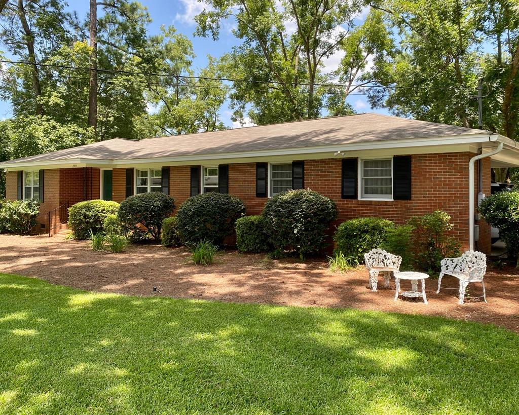 Gardener's Delight!  This three bedroom brick home is situated on a gorgeous 1.15 acre lot, just minutes from downtown Thomasville.  The interior features a split floorplan with hardwood floors, formal living room, updated master bath with a tiled walk-in shower, fresh paint throughout and a large kitchen with breakfast area that opens into den with sliding glass doors that offer views of the private back yard.  Outside you will find a beautifully manicured double lot with established flower beds and plenty of room to play, garden or simply enjoy nature.  Make an appointment today - you don't want to miss this one!