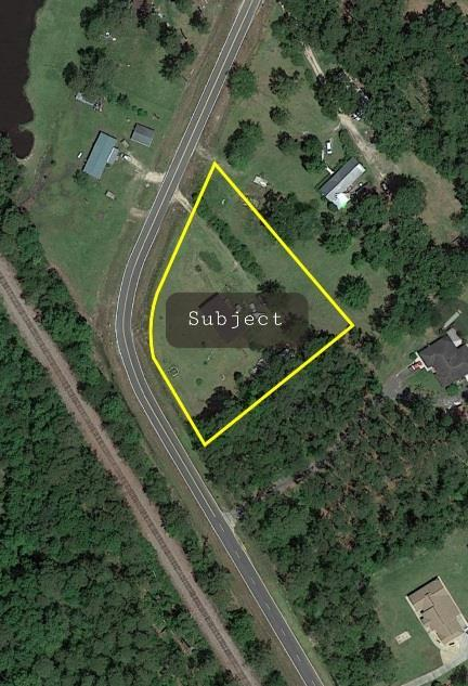 :  Mobile lot almost 1 acre with lots of road frontage.  Property has septic tank and water provided by neighbor.  RV power hookup also available.