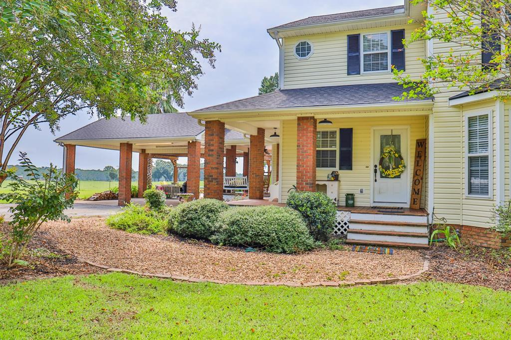 This country home is a true southern gem with a welcoming wrap around porch. Conveniently located near Thomasville & Moultrie & in the highly desirable Hamilton School district. The kitchen features stainless steel appliances, including a sophisticated smart hub refrigerator, custom over-sized bar w/ cook top, bay window, farm sink, many cabinets & pendant lighting. The family room with stone fireplace is just off of the kitchen. The dining room overlooks the huge back deck and in ground pool complete with hot tub.  Wide plank pine floors are in all of the common areas. The over-sized downstairs master bedroom features an attractive accent wall. The spacious master bath has a walk-in closet, double vanities, track lighting, jetted tub and separate shower. Upstairs has a stairwell overlook, 2 additional bathrooms, 2 bedrooms and a large bonus room. A 30 x 30 wired workshop with concrete floors is perfect for equipment or projects. Invite your friends and family over to enjoy with you!