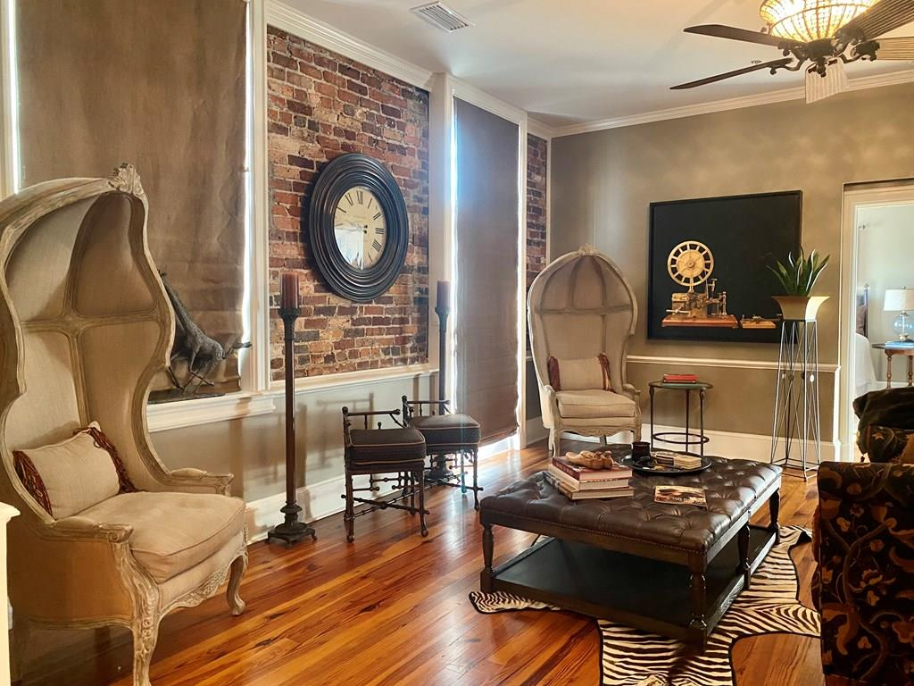 Nestled in historic downtown Thomasville, this 1553 square foot luxurious 2 bedroom / 2 bath Condominium is just a short elevator ride up to the Top floor. With the comforts of home and attention to detail, you will enjoy custom millwork and exposed brick walls that is the signature of living in The Mitchell House. The well appointed kitchen and gorgeous bar area boast, granite countertops, wine fridge and up to date stainless appliances that makes for the ultimate cooking and entertaining experience that is sure to be remembered. Pair all of this with the ONLY condominium in the building with TWO LARGE PRIVATE ENTERTAINING BALCONIES (Both are estimated  8FT X 22FT) with unforgettable sunset & Skyline views- This is the definition of  living your best life. Additional features are, spacious walk in closets apprx. (7ft x 8ft), double bathroom vanities, separate shower and soaking tubs and reserved parking. Call today for a private tour of this gorgeous property.