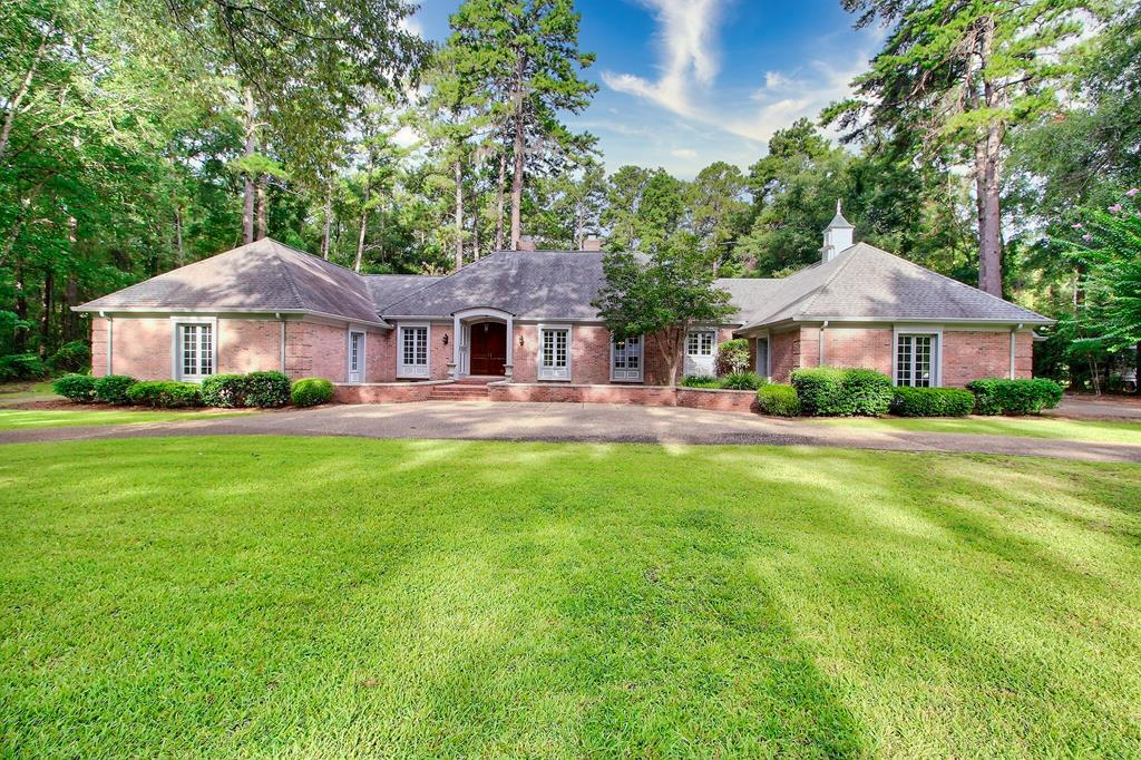 NEWLY IMPROVED: Classic European-inspired architecture in one of Thomasville's favorite in-town neighborhoods, minutes to the bricks of downtown, hospital, country club, and schools. Brick, one-story home features 4 BR/ 5 BA in 4,870 sf on over 3 acres. Recent updates include new paint, remodeled bathrooms, new carpet & light fixtures. Master suite has oversized bedroom, his/hers bathrooms w/ generous closet spaces. Gourmet kitchen features double island w/ Subzero refrigerator/freezer, Wolf 8 burner gas-cooking, fireplace, imported granite counters & reclaimed wide plank wood floors. Formal living & dining rooms both have wood floors & fireplaces. Family room features space for billiards, movie night or gathering around the river rock fireplace. Family room also has wet bar w/ beverage station among custom built storage cabinets plus easy access to covered patio & outdoor fireplace. Heated/cooled 625 sf accessory building could be converted to a guest house or pool house.