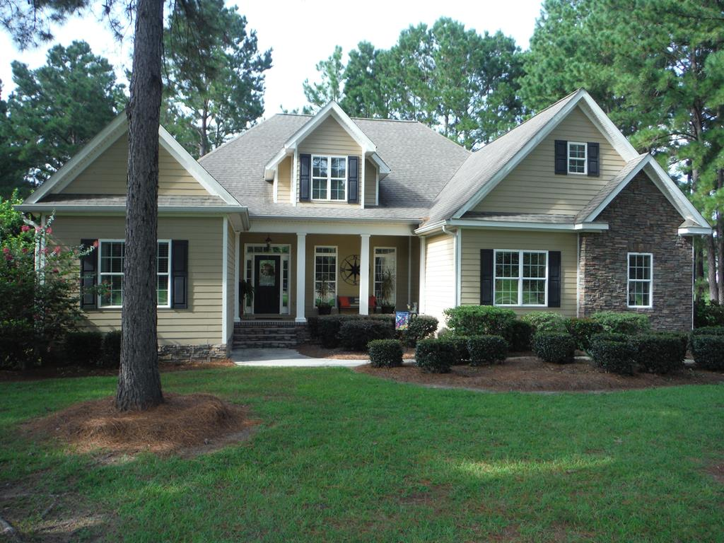 """See Virtual Tour Now at.    https://unbranded.youriguide.com/137_sweetbriar_lakes_dr_thomasville_ga                  LOCATED  in popular Sweetbriar Lakes Subdivison. This home has 4 bedrooms, 3 1/2 baths. The downstairs consists of 3 bedrooms 2 1/2 baths, a great room with a Vaulted ceiling, built in surround sound system with a 70"""" Flat Screen tv mounted over the Stone Fireplace. Luxury master Bedroom, Trey ceiling and walk-in closet, Large Master bath featuring a Whirlpool tub, Walk-in shower and his and her Vanities. There is also a keeping room to spend your evenings relaxing with a beautiful view of the lake. Kitchen has all Stainless Steel Appliances, an abundance of cabinets, and Hard Surface Countertops. The upstairs has a large bedroom with bath and a bonus room which can be used as a 5th bedroom. Custom Crown Molding and Trey ceilings throughout the home. There is an extra large 2 car garage, and a cozy back porch with Large Deck. Owner/ Real Estate Agent Lic # 182798"""