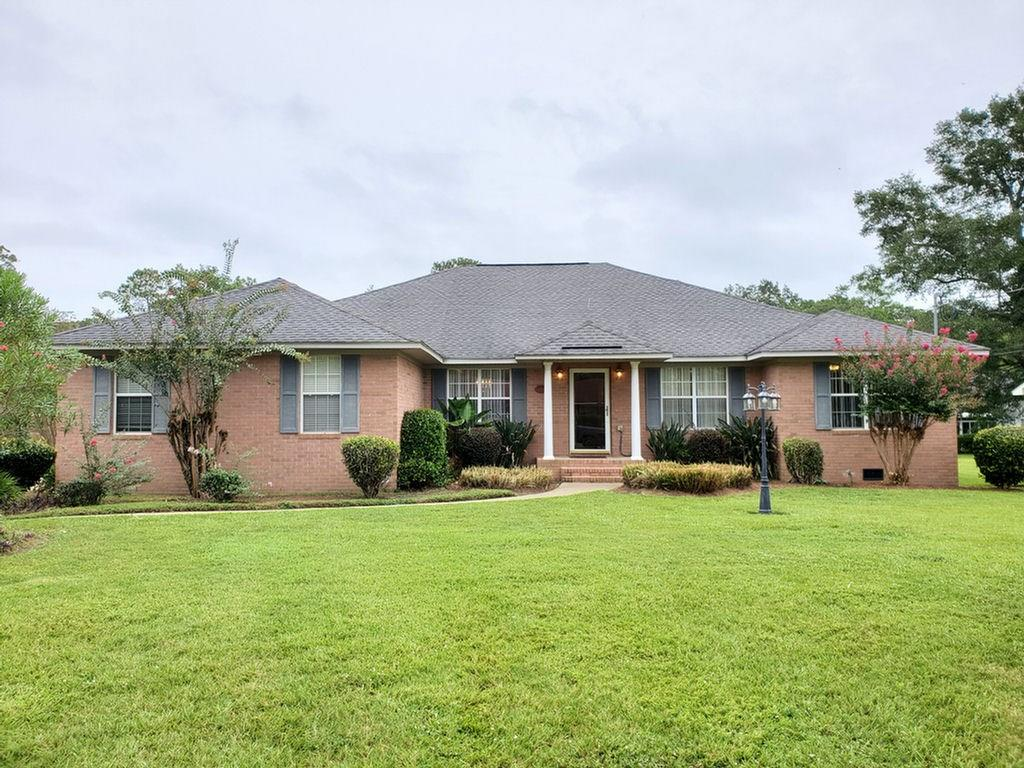 Don't miss out on this home offering 2600 sqft freshly painted in an established south of the city limits of Thomasville. There are 3 bedrooms 2.5 baths with space for a 4th bedroom if needed. Kitchen has stainless appliances, granite countertops with bar & breakfast nook. If you like to entertain family and friends then you will love having a formal living room, dining room, family room and large den. Large master bedroom with huge walk-in closet and master bath has dual vanity with enormous custom walk-in shower. There is a private office with it's own entry. The 2-car garage can easily be converted in a screened in room whenever needing to have additional play or work space. 20x12 storage building and car port included. Call for your private showing today.