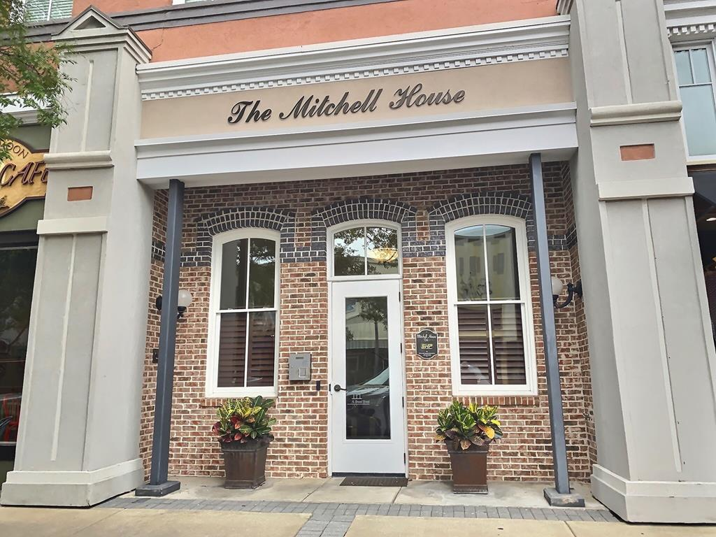 If you are looking for a spacious, very livable and quiet condo this is the perfect one for you. It is a second floor corner unit with large rooms and so many upgrades. The location gives you privacy yet all the enjoyment of living in the heart of downtown Thomasville. It features two bedrooms and two full bathrooms with generous size attractive tile showers; elegant trim and crown molding; fireplace with cast iron mantel and gas logs, and two wall mounted TV's; kitchen with upgraded stainless steel appliances and granite counter tops; wine cooler; pantry and under counter lighting. Also has abundant storage space.