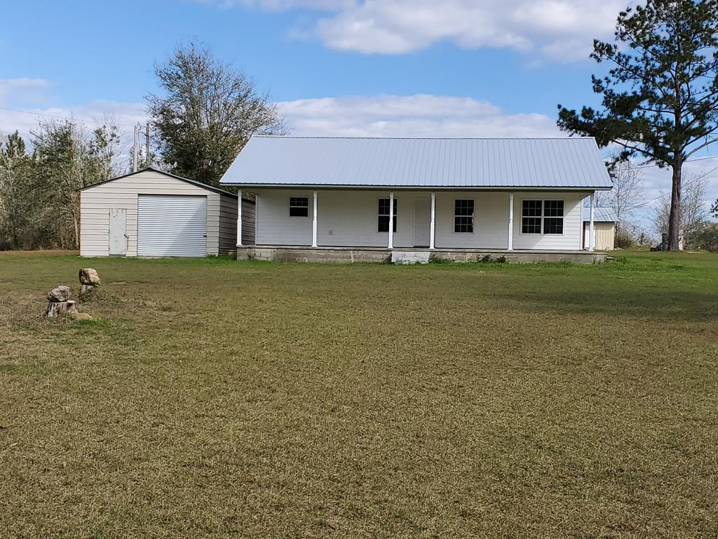 If you are looking for country living, this is a great starter home or retirement home near Lake Seminole! This 2 bedroom, 1 large bathroom sits on 5.19 acres. It has a detached garage and plenty of room to roam. There is a rocking chair front porch, so you can watch the sunset every afternoon. Call today for your showing.
