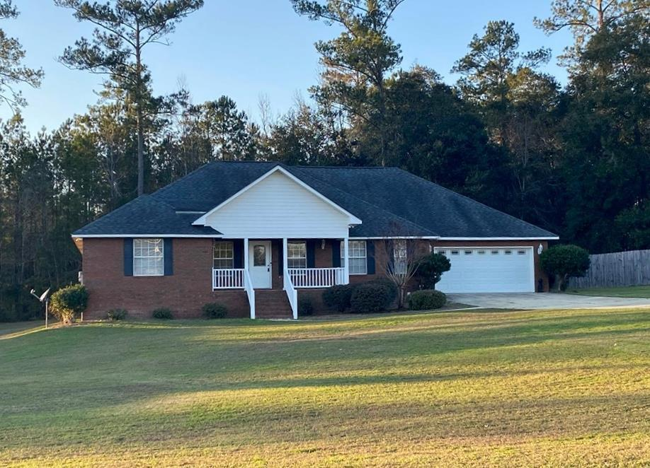 Space for the whole family in this 4Bd/2Ba brick home in Hunter's Cove! This home is situated on .67 of an acre with a 2 car garage and concrete drive. The interior features a large family room with vaulted ceilings, sun room with tile flooring, formal dining room, and over-sized kitchen. The kitchen comes complete with all appliances and offers lots of cabinetry, peninsula bar, and breakfast nook. The bedrooms are arranged on a split floor plan with an extra large master suite. The master bath has a garden tub, separate shower, and double vanities. There is plenty of yard for the kids to run and play! Call today for your private showing.