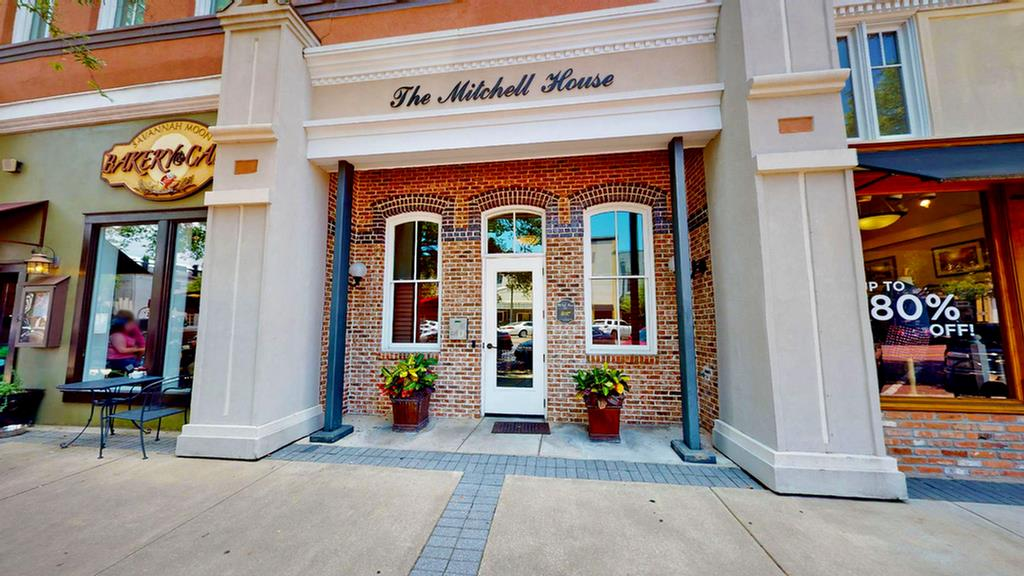 Enjoy living on the bricks in Beautiful downtown Thomasville. Just steps from fine restaurants, boutique shopping, unique entertainment venues with dedicated parking. This traditional style, luxury 2 bedroom 2 bath unit has expansive views of Broad St. This stunning condo unit has original pine flooring, exposed brick walls, 12 foot ceilings, elaborate molding and a high end gas log insert in the fireplace. The open floorplan has comfortable living and formal dining areas. The custom kitchen is well organized with good storage and high end stainless steel appliances including a wine cooler. Bonuses  include custom built ins for storage and book shelves. The second bedroom includes a unique custom design after the designer Steve Gambrel. This condo comes with 2 storage units located in the basement of the building.