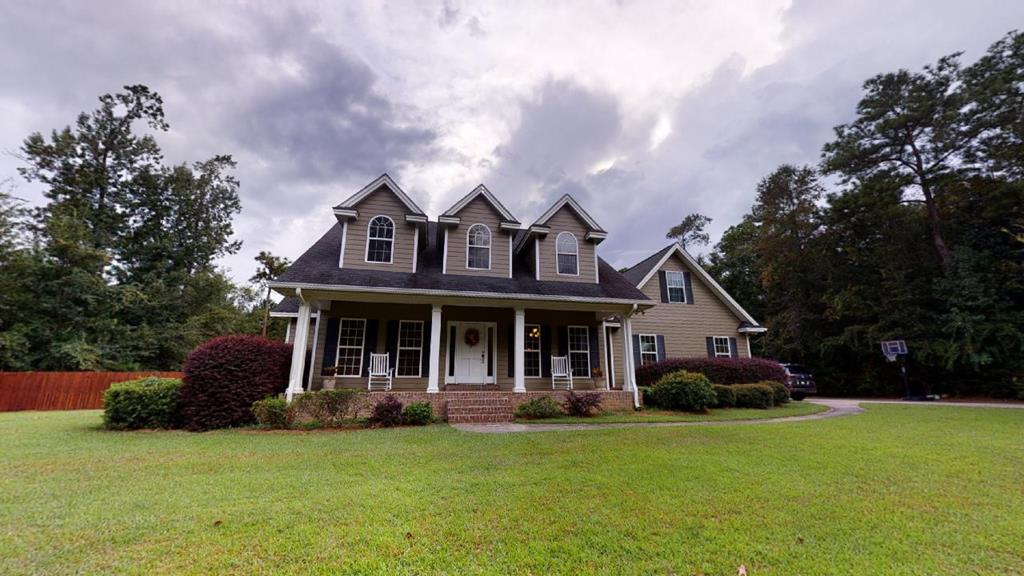Tucked back in a wooded setting, this custom built home offers privacy and room to spread out. Convenient to Tallahassee, Cairo and Brookwood School the property is just two miles to downtown Thomasville. Offering open living space and a split floor plan, you'll find there's room for everyone whether it's hanging out with family or entertaining friends. All bedrooms and baths are on the main floor along with the kitchen, breakfast room, family room and dining room.  Vaulted ceilings, gas fireplace, hardwood floors and tons of large windows create a space that is both welcoming and functional. Upstairs is a large bonus space with a closet that can be used as a fourth bedroom if needed. The two car garage has extra space for storage or to create a workshop area. The fenced in backyard has lots of room for kids and pets to play. A duck pond and one mile jogging/biking path complete the setting on this pretty 6 acre property.