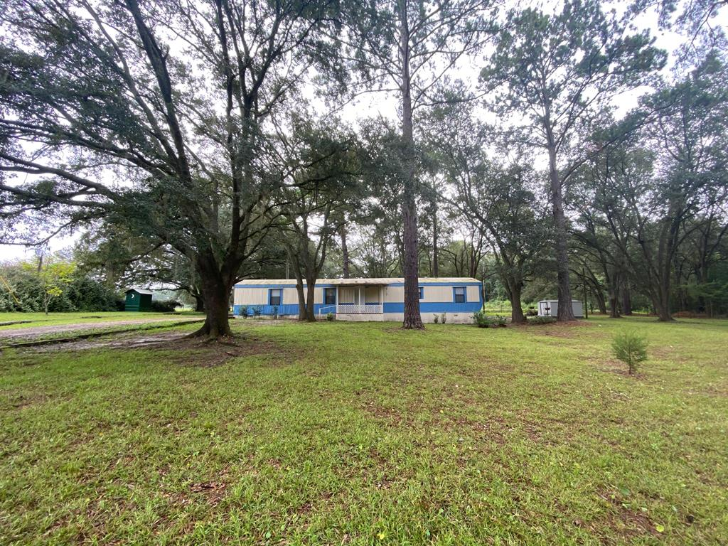 Beautiful tract of land with rolling land, pastures, woods, and large live oak trees,   Road frontage on Knights Ferry Rd and Pine Branch Lane.  Perfect tract for horse lovers!!  Fenced and crossed fenced pastures.   Call today for an easy appointment.