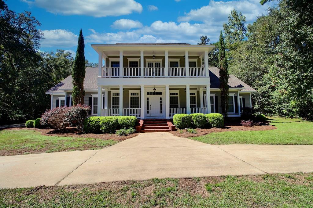 Just WOW!! This magnificent 5 bed 4 bath home with an office is in one of Thomasville's finest gated communities. The secluded Antebellum style home has upstairs and downstairs verandas and is situated on 1.21 acres with a beautiful sparkling pool complete with slide, diving board and hot tub! The cathedral ceilings have detailed crown moldings in the great room with a gas log fireplace and built-in book shelves. The separate formal dining room and kitchen with cherry wood cabinets, stainless steel appliances, and a bar with room for 6 stools is perfect for dinner parties and entertaining. The master suite is downstairs with hardwood floors, his and her closets, and a huge double head tile shower. The home has been very well maintained and has just been freshly painted inside, new carpet installed, and has an encapsulated crawlspace with dehumidifier and transferable termite bond. Don't miss out on this fabulous home in a great neighborhood!