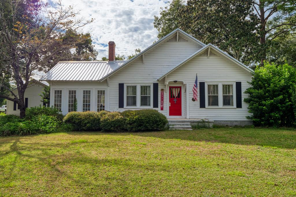 Beautiful historic home with lots of space and NEW metal roof!  .  This 5BR/4BA home has large master suite with large master bath, large dining room, sun room, two living rooms.  Outside, you'll find a large yard, partially fenced backyard, and large detached garage.