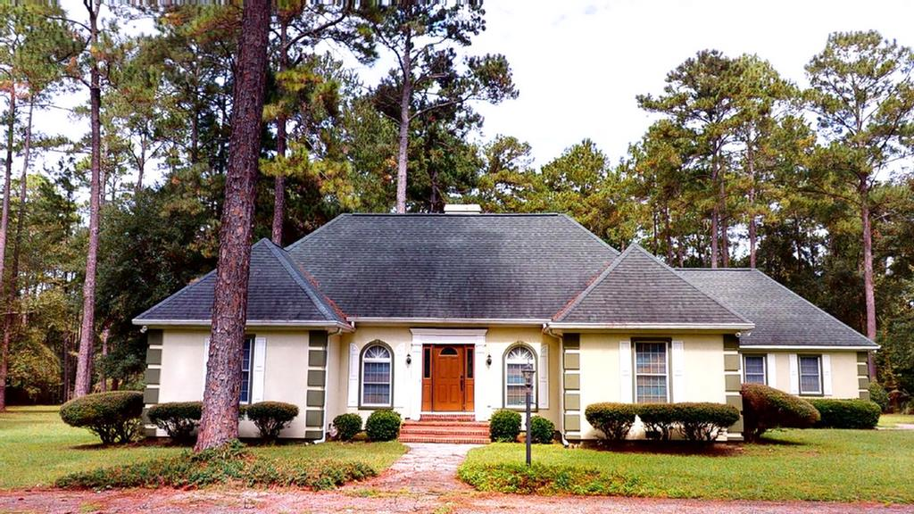 """Just outside of  town on 3.37A  sits this lovely 3/2 home. L.R. contains a gas f.p.; eat-in kitchen with lg. frig. and matching freezer, paneled like cabinets; separate D.R.; Master suite has plantation shutters and sitting area; Master Bath contains a luxury shower, jacuzzi, toilet area, double vanities and walk-in closet. Deck, Garage is 21x21, with 6x13 utility room; Shed and lean-to on property.  Exterior is called """"tabby.""""  Windows are screened. Roof is 8.  Some updates and repairs are needed and house is priced accordingly."""