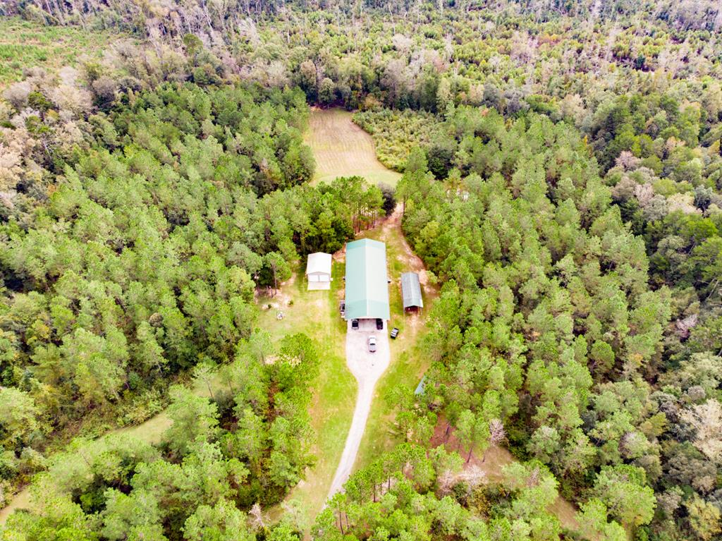 Unbelievable recreational opportunity! Owner Financing Available! This 115 acres has absolutely everything a serious recreational buyer is looking for: spacious 4,480 sq. ft. (under roof) barndominium with 2,400 sq. ft. heated and cooled 1 BR/2.5 BA living quarters complete with kitchen, screened porches, AC, power, water, septic, and more, workshop/garage and pole barns, covered outdoor gazebo, fishing pond, creeks, planted pine and big natural hardwood timber, and strong populations of big deer and turkeys. Located in Attapulgus, GA just 45 minutes from both Tallahassee, FL and Thomasville, GA, with direct frontage onto paved US Highway 27! If youre looking for privacy thats an easy drive to amenities, and everything you could want in a recreational/investment property, this one is a must-see.  The Bardominium is 112' x 40' under roof. It boasts a very large entertaining or storage area with plenty of room for large groups of people or equipment. The living quarters is 2,400 sq. ft