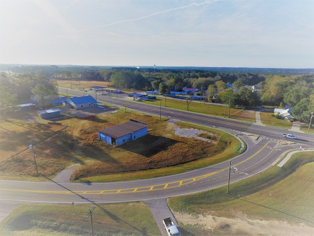 """Excellent corner  location.  Two Curb cuts for easy access.  GA133 has been going through major widening back towards Valdosta.    The property is a little over a 1/2 mile from Recreation Fields  and Wal-Mart. Over 500+/-' of Road frontage combined on 133 and Old Adel Road.  Good level site.  2771+/- sq ft block building on property.....there may be some applications for this building.  Just a shell of a building.    GA AADT most recent Traffic Count at 17,400.  With completion of road work on 133, traffic may increase.  5 lane road with Center Turn for easy in and our.  Check with city about letter of availability for specific utility needs.. Zoned C-3 Commercial District in the City Limits of Moultrie.  Property has a """"No Further Action Letter."""""""