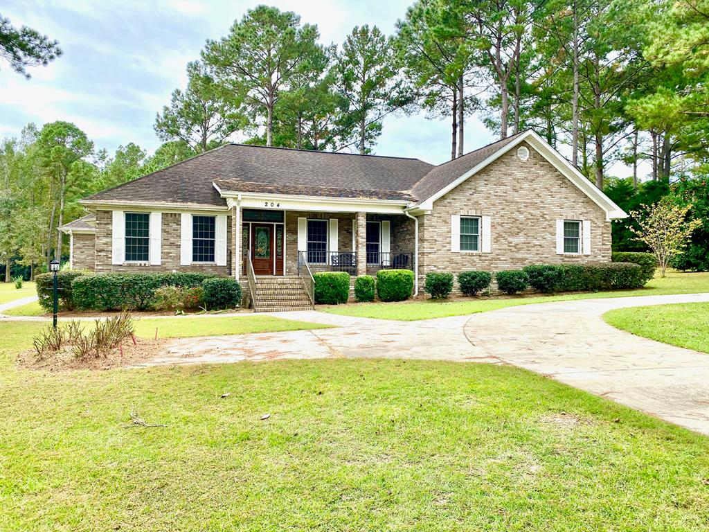 This beautiful custom built brick home sits on a huge corner lot in A Place in the Woods Subdivision and tons of features. It has a formal dining room. formal living room, as well as a large family room with custom built-ins. The family room overlooks the fabulous covered porch and huge entertainment patio. The spacious kitchen features solid surface countertops, a built in desk, breakfast nook, and raised bar overlooking the living room. The home has solid hardwood floors throughout with tile in the kitchen and baths. The huge yard has zoned irrigation, an excellent garden space, and huge mature fruit trees. The 2 car garage also has a separate workshop that can be heated and cooled if desired, and the home is plumbed for a water filtration system.