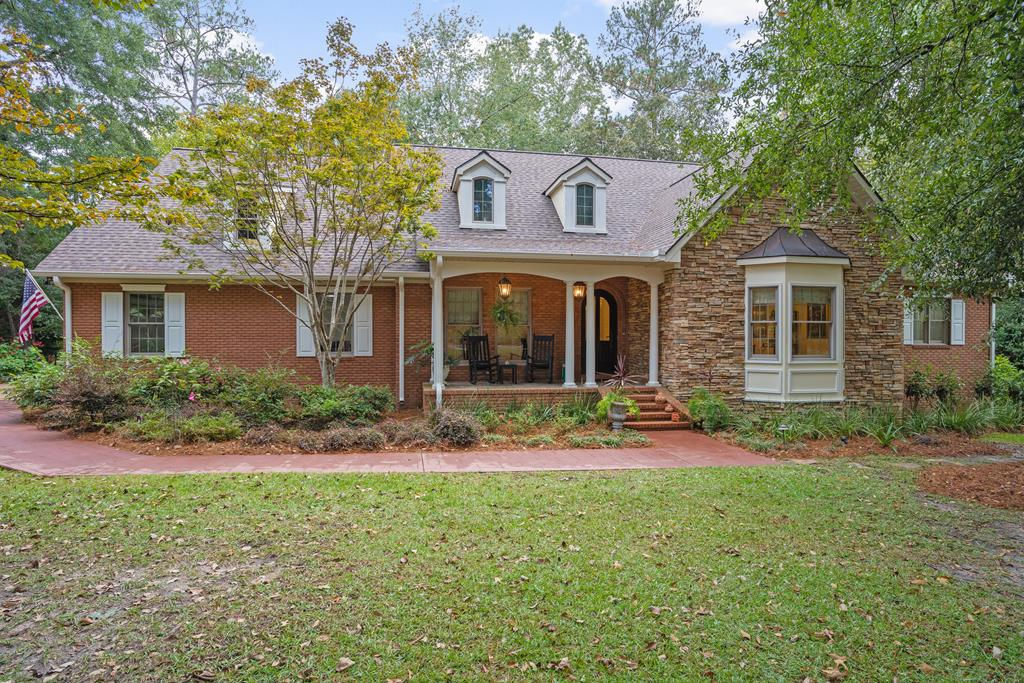 This beautiful Lakefront home is located in the highly desired Beachton Place subdivision, between Tallahassee and Thomasville. Pride of Ownership shows when looking at this 3 bedroom 2.5 bath home, situated on 1.23 acres.  It features a nice size family room with gas fireplace and built in cabinets, formal dining room, gourmet kitchen with updated Corian countertops, tile backsplash, stainless steel appliances including a Viking range. Beautiful mastersuite with stunning masterbath, real hardwood floors, lots of crown molding, 11 foot ceilings, sunroom, plus 3 car garage and additional storage above the garage, screened porch, deck, irrigation and a beautifully landscaped yard, with LED lighting and an awesome view of the lake!