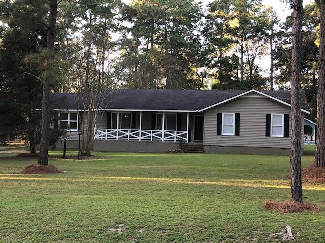 This home is located close to schools and shopping, but still in the county. The home features 3 bedrooms, 2 baths and sits on approx 1.50 Acres. If you are looking for a move in ready home, look no further. This home has newer countertops, interior paint, flooring, light fixtures, faucets, HVAC, pool pump, pool liner, door knobs and hinges. This is just a few of the many items that have been updated. You walk into a foyer that leads to the large living room. The dining room is located off of the living. The open kitchen is large enough for a breakfast area. The bedrooms are all located on the right side of the home with spacious closets. If you like entertaining, you will love the backyard. The screened in porch has a great view of the pool. The covered party area is located behind the pool and has a bath area. In the back of the yard is a small septic tank, electrical and water hook up for an RV. The 24x28 workshop is on a separate meter and has two roll up doors. This is a must see.