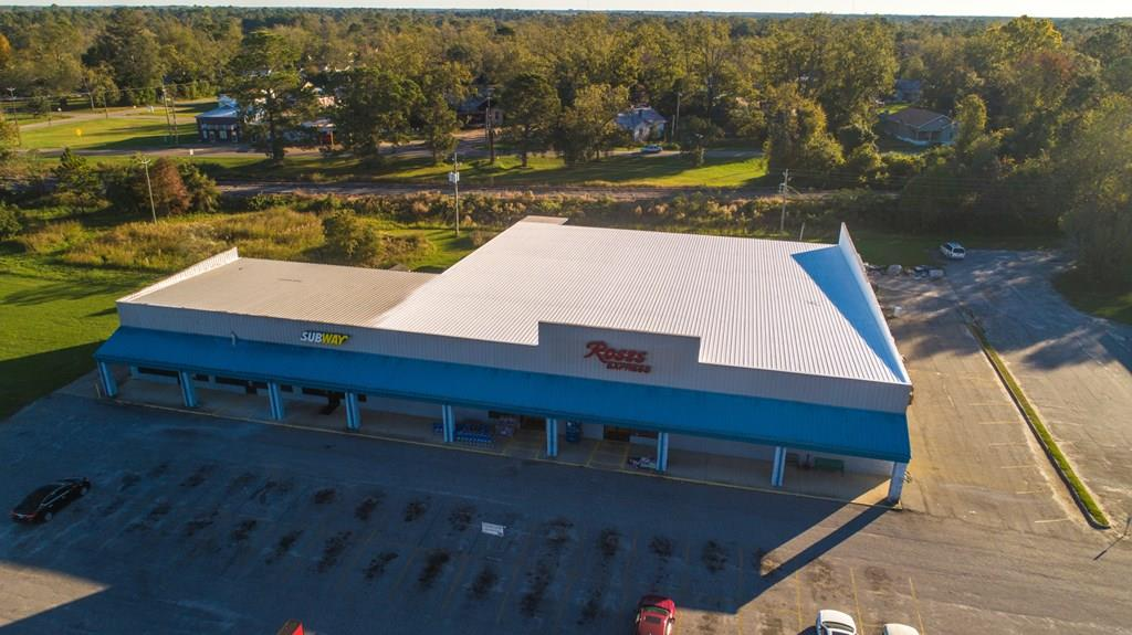 This shopping center offers 17,872 SF of retail space and ample parking..  The largest space has 15,372 SF that includes retail space, storage, managers office, break room , 2 lavatories and a 24x50 truck well.   It is presently leased until July of 2022. The center also offers a  1,000 SF sandwich shop currently leased until 2025 and a 1,500 SF clothing retail shop.  Recent improvements include two 20 ton Carrier CHA units and roof has been waterproofed and sealed. Centrally located on 1.61 acres.