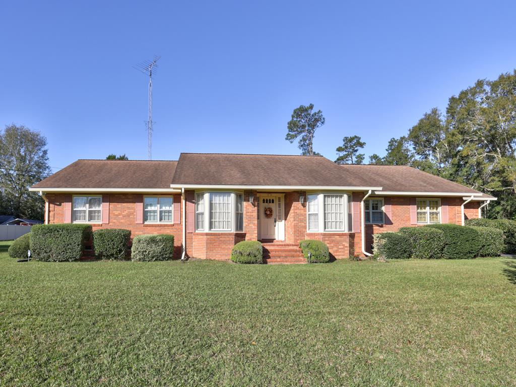 LARGE WELL-MAINTAINED BRICK HOME - This 4 BR/2 BA and 2 half bath home has so much storage space! It has 12 closets inside, built in bookshelves with storage in the family room, 2 car open garage, additional garage (29 x 27)  that housed 3 cars, and an insulated warehouse (60 x 21) that housed 2 motor homes with septic and water hookups!  Other features of the home include formal living and dining rooms on each side of the foyer,  a kitchen with plenty of quality wood cabinets, a utility room, two large size offices that could easily be converted to other uses, a large den with wooden beams and a fireplace that has a gas feature to assist the wood burning, a large sunroom across the back of the house with a sink and built in grills, and a patio area off of the sun room.  Conveniently located to Cairo, Thomasville, and Tallahassee, this is a home that you really need to see to appreciate!  Make an appointment today!