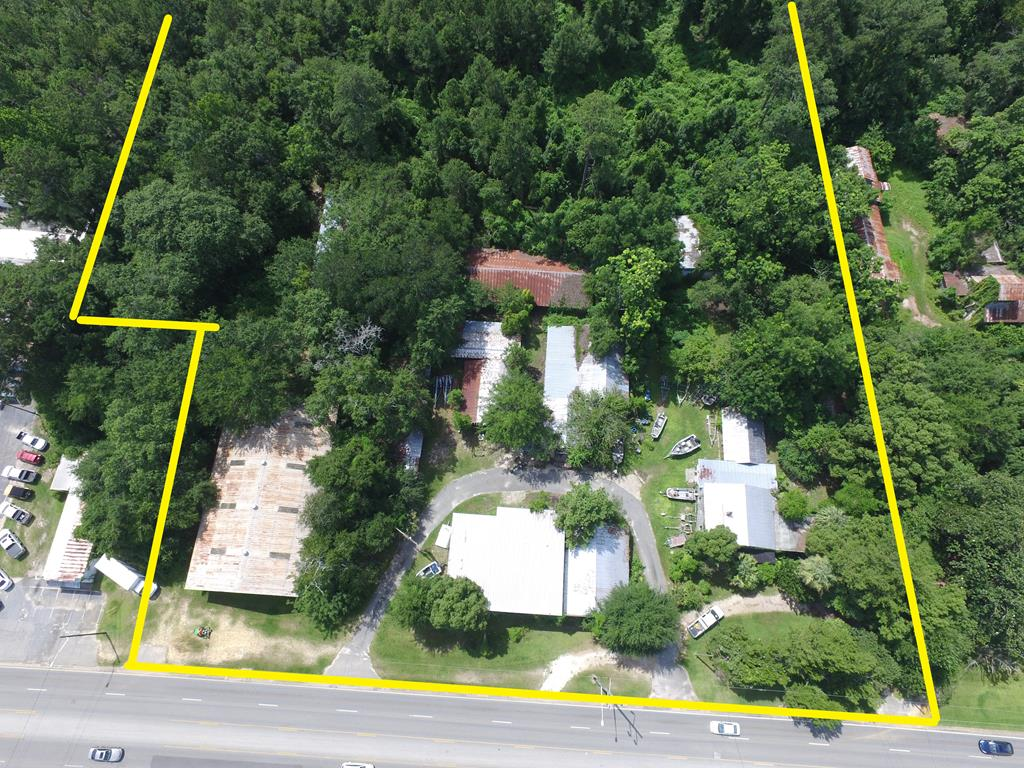 7.81 Acres includes  Main Boat Warehouse, Two Story Main Older Bellamy Boats Building, 1222 East Jackson Street Residential Home Block, 3K+Sq Ft. Two Story, Multiple Sheds and Barns. Tax Record Sq Ft...verify. Multiple Curb Cuts....16,600 2019 DOT Traffic Count.  The last large acreage site on East Jackson Street.  397' of Road Frontage.  Consider how this property can be divided.  Multiple buildings and warehouses.  Main Warehouse is 5,760+/- Sq Ft.  The Boat shop building has a fully functional floored second floor.  There is a Two Bay Warehouse behind the home that houses a camper and a sailboat.    The R-1 Zoning could seek a higher density zoning that would take advantage of proximity to the YMCA and Ball Fields.  Additional property available towards Sally Street. Video and Packet Available.  Consider all the activity and new construction on East Jackson Street in 2020.  Having that center turn lane on East Jackson St. is a big deal.