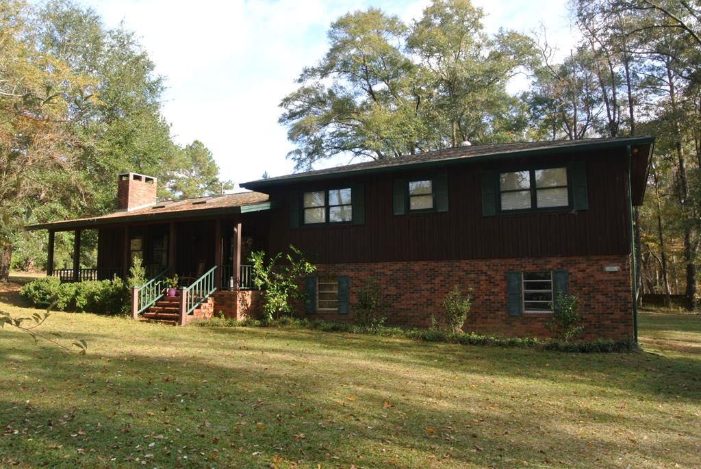 Large family home just outside of city limits.  Property is 4.7 acres, split level home in a private setting in a desirable location.  Home has 4 bedrooms,  two living areas, formal dining room.  Ample sized kitchen.  Nice fireplace. Impressive woodwork throughout.  With current lumber prices, this is of great value and very unique.   2  bay garage.   In-ground pool, private well and large wired shop with a lean-to.  Home does need a little bit of work.  Master bathroom remodel needs to be finished, outside decking finished and some other smaller projects but a very unique opportunity for someone with remodeling experience or just the grit to get some sweat equity. SOLD AS-IS!!
