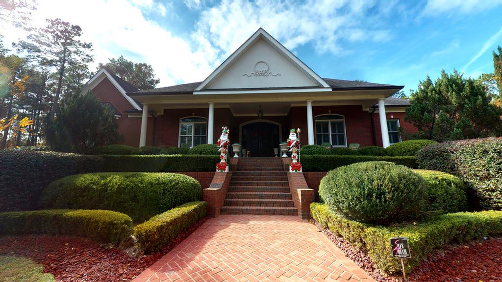 Private and prestigious, this luxurious custom home sits at the back of Pebble Creek, a highly sought after Thomasville neighborhood convenient to historic downtown and Tallahassee. The main level offers 4 spacious bedroom suites each with a private bath, a large media room with private bath, gourmet chef's kitchen and wet bar, separate office, and comfortable family room overlooking the pool. A second bonus room is located upstairs via a back stairway offering privacy from the main level. Accessible from multiple rooms, the custom pool & large patio will provide hours of fun. A spacious courtyard is centered between the main house & guest house which offers another 2 bedrooms, 2 baths & full kitchen. An oversized 3 car garage with 2 storage rooms & separate 4th garage offer plenty of parking and storage. Over 7 private acres surround the home, and also feature a basketball court & batting cage. Both comfortable living and gracious entertaining opportunities await your family & guests!