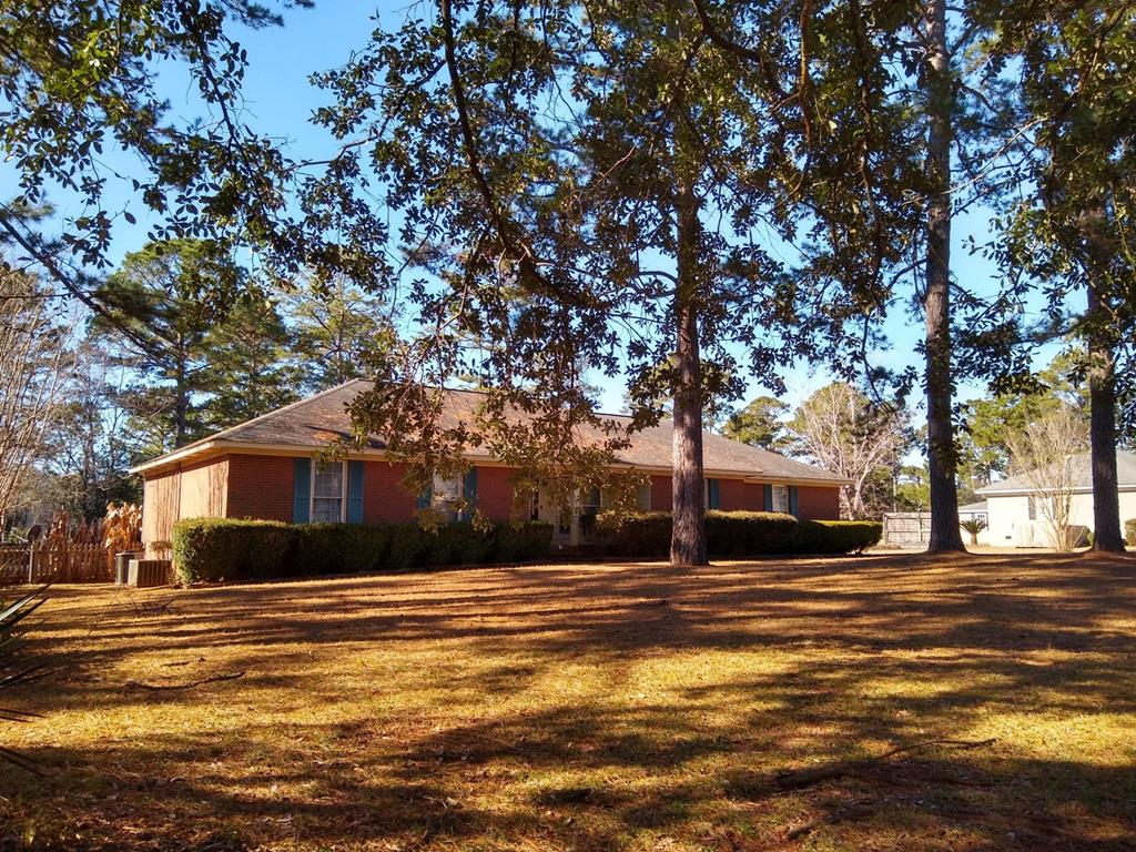 Large well kept brick home with almost an acre in Springfield Subdivision,  Near highly rated Robert Cross Middle school and Live Oak Elementary. Two mater suites, large living areas and a beautiful pool make this home unique.  Wont last long, See it before it's gone.