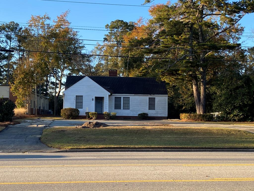 High traffic area. One story commercial building with detached garage for additional storage on over half an acre. 85 feet road frontage 300 feet depth. Paved six car parking lot. careful when entering building