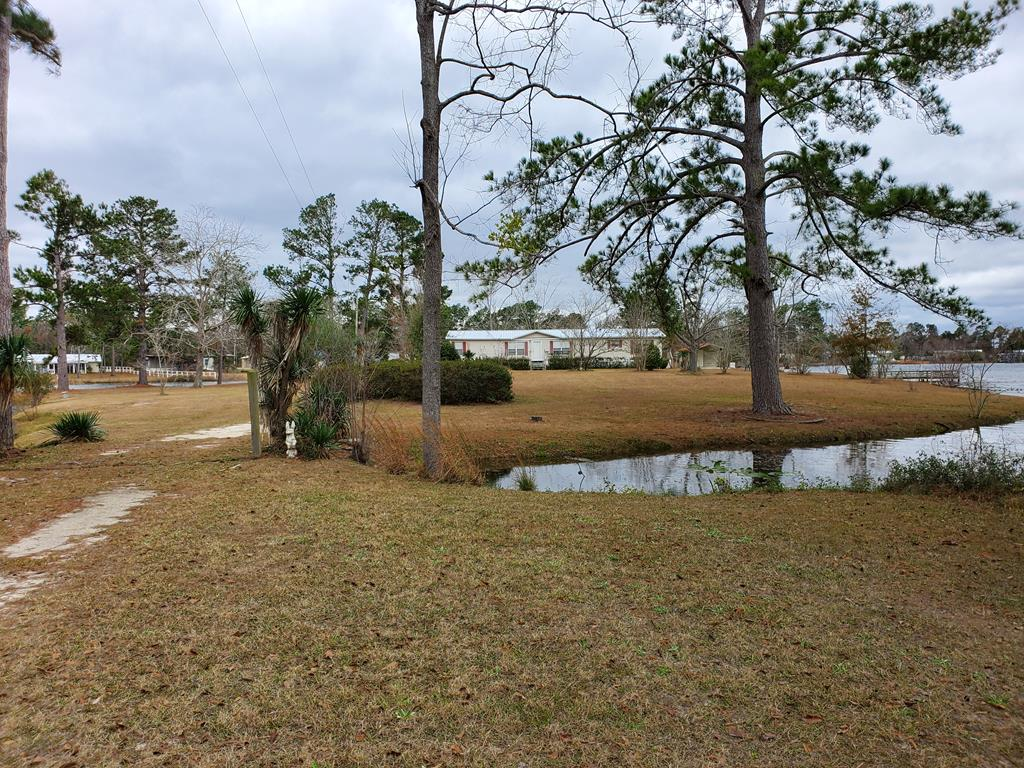 Come live on an Island in the middle of Lake Carroll!! This is the ONLY property that sits on an Island in the middle of Lake Carroll. The land is 1.81 acres and features a 3 bedroom, 2 bath mobile home with an amazing sunroom that looks out over the water. This property will make you feel like you are king of the land! You can fish 360 degrees around the property. The home has been very well kept. This is a rare opportunity, so you don't want to miss out. Call today for your showing!