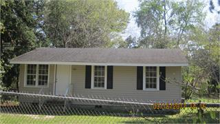 """Investment property now available.  This is a 2 bedroom, 1 bath home features a living room, eat-in kitchen, a laundry room with storage cabinets and direct access to the fenced in backyard.  There is a 3rd """"bedroom"""" that doesn't feature a closet but could accomodate for a bedroom.  Large yard space.  Close to downtown, parks, restuarants and convenient to the local grocery store and shopping."""