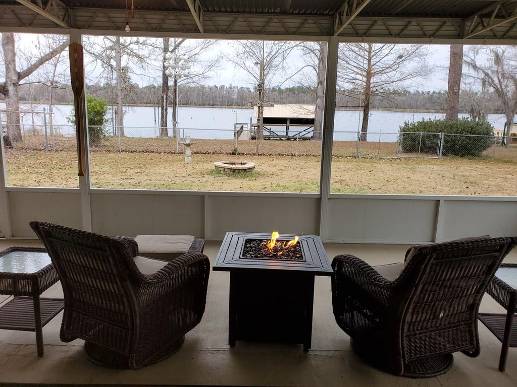 Talk about LOCATION!!! This fantastic property on Lake Seminole sits facing west overlooking Cypress Pond, where you will catch the beautiful sunsets on your boat dock or under your 20 x 40 screened in porch! This home has been completed refurbished with 3 bedrooms, 2 full baths and comes fully furnished. Outside there are two storage sheds and a double carport. The entire property is chain length fenced and you have your own well. It even comes with your own lawn mower. There's nothing you would have to so at this property, just pack your clothes and come on!!!! It's also within walking distance from the new restaurant opening soon! Call today for your showing!
